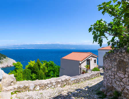 Wonderful romantic summer afternoon landscape coastline Adriatic sea. Narrow streets paved with stone. Krk island. Croatia. Europe. Editorial