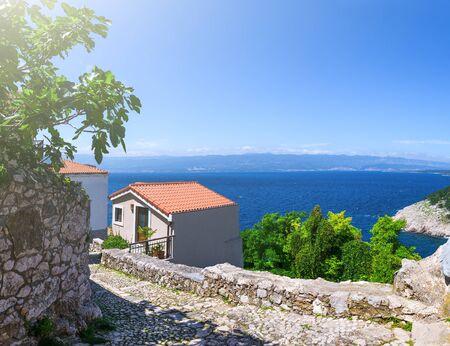 Wonderful romantic summer afternoon landscape coastline Adriatic sea. Narrow streets paved with stone. Krk island. Croatia. Europe. Editorial