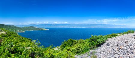 Wonderful romantic summer afternoon landscape panorama coastline Adriatic sea. The magical clear transparent blue water in the bay. Krk island. Croatia. Europe.