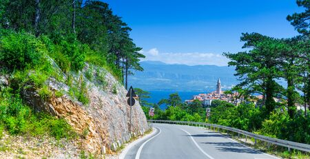 Serpentine way to wonderful romantic old town at Adriatic sea. Vrbnik. Krk island. Croatia. Europe.