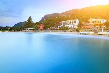 Long exposure landscape of Paleokastritsa famous sand beach in close bay on Corfu island at dusk, Ionian archipelago, Greece. Stock Photo
