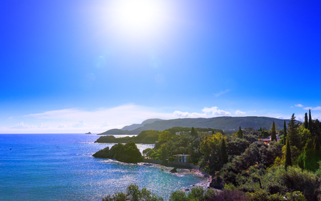 Beautiful summer panoramic seascape. View of the coastline into the sea bays with crystal clear azure water. Paleokastrica. Corfu. Ionian archipelago. Greece. Stock Photo