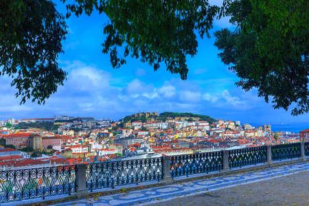 View of old town Lisbon and Sao Jorge Castle from Miradouro de Sao Pedro de Alcantara. Portugal.