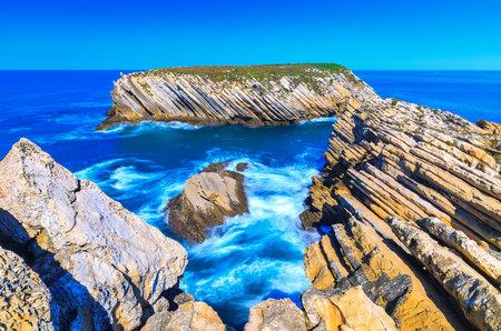 Wonderful romantic seascape. Coastline of island Baleal of the Atlantic ocean in Peniche, Portugal. Geological sediments sandstone tilts rocks. A daylight scene longexposure with ND filters technics. Stock fotó