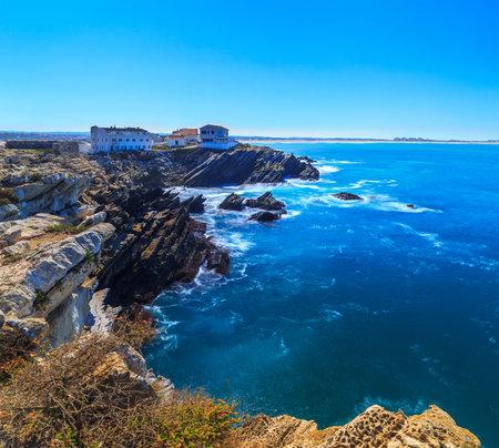 Wonderful romantic seascape. Coastline of island Baleal of the Atlantic ocean in Peniche, Portugal. Geological sediments sandstone tilts rocks. A daylight scene longexposure with ND filters technics.