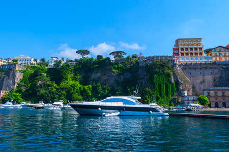 Seascape beautiful famous coastline. Yachts, boats and boats in the harbor. Seaside panoramic view of Sorrento, Naples, Campania, Italy.