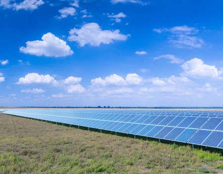 Solar panels, photovoltaic, alternative source environmentally friendly energy. In the backlight sunbeam light. Stock Photo