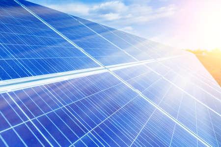 Solar panels, photovoltaic, alternative source environmentally friendly energy. In the backlight sunbeam light. Zdjęcie Seryjne