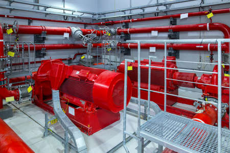 Industrial fire pump station. Reliable and trouble-free equipment. Automatic fire extinguishing system control system. Powerful electric water pump, valves, and pipelines for water sprinkler.