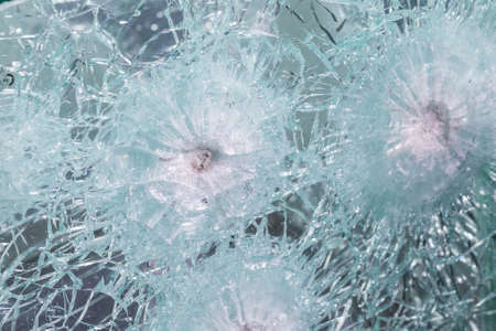 Bulletproof glass samples test. Glass passed the test after shots at him with a firearm.
