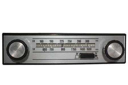 Vintage auto radio over isolated background. photo