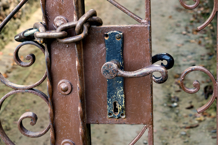old locked gate with lock
