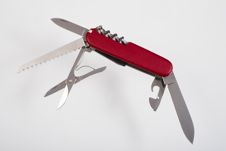 Red multitool open knife isolated Stock Photo