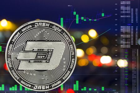 Coin cryptocurrency Dash on night city background and chart