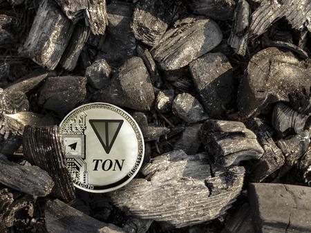 Silver coin of Con lies on coal. Mining Cons.