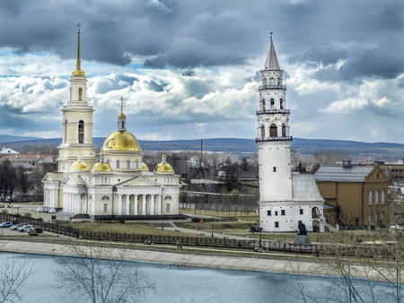 Spaso-Preobrazhensky Cathedral in the city and Nevyansk leaning tower. Famous Nevyansk Tower and Spaso-Preobrazhensky cathedral church. Nevyansk leaning tower was built in 1732