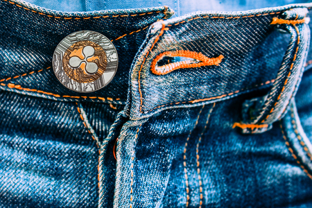 coin Ripple instead of buttons on jeans. new fashion. Archivio Fotografico