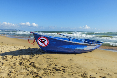 digital detox concept. old blue boat and sign no wifi on the sand by the sea