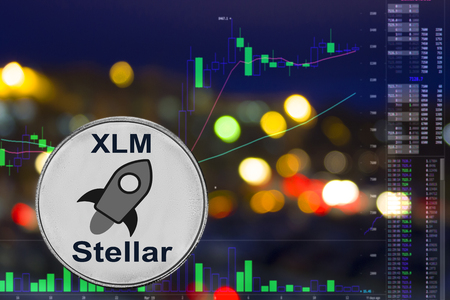 Coin cryptocurrency Stellar on night city background and chart.
