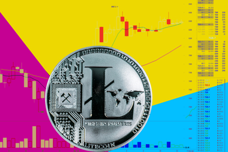 Coin cryptocurrency Litecoin on chart and yellow neon background. Imagens