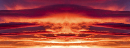 dramatic bright purple red sunset with beautiful clouds