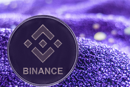Coin cryptocurrency Binance and neon fabric background. BNB