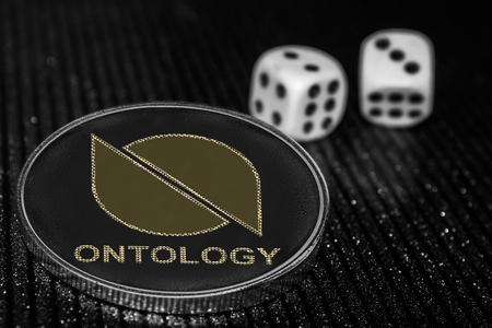 Coin cryptocurrency Ontology ONT and rolling dice.