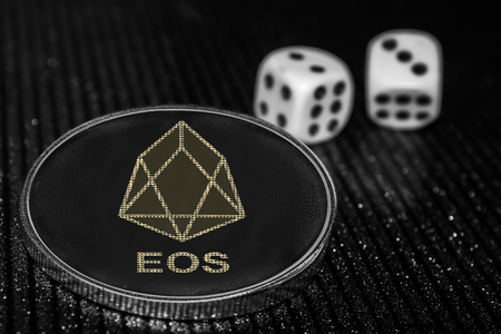the coin cryptocurrency  EOS and rolling dice.