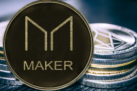 Coin cryptocurrency Maker on the background of a stack of coins. MKR coin. Stock Photo