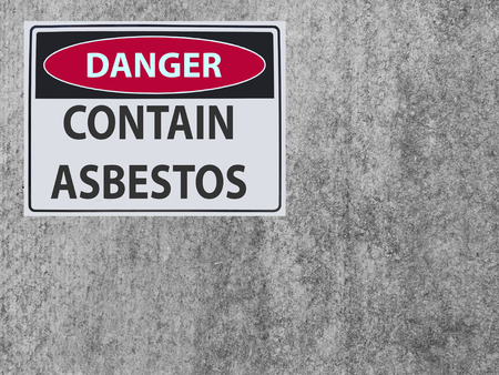 sticker Sign danger contain asbestos at the plaster asbestos wall Stock Photo