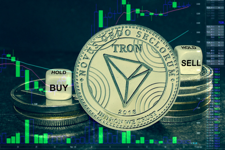 The coin cryptocurrency tron trx stack of coins and dice. Exchange chart to buy, sell, hold.