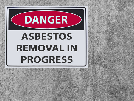 sticker Sign danger asbestos removal on the plaster asbestos wall