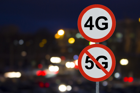 Signs 4G no 5G and the night road with cars