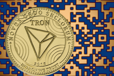 tron trx coin cryptocurrency on the background of crypto code Фото со стока