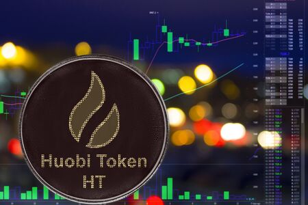 Coin cryptocurrency huobi token on night city background and chart. HT Stock fotó