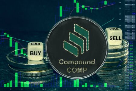The coin cryptocurrency COMP token stack of coins and dice. Exchange chart Compound to buy, sell, hold. Stockfoto