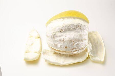 freshly peeled pamelo on a white background