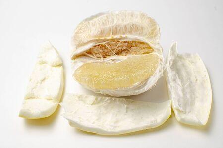 freshly peeled pamelo on a white background Stock Photo