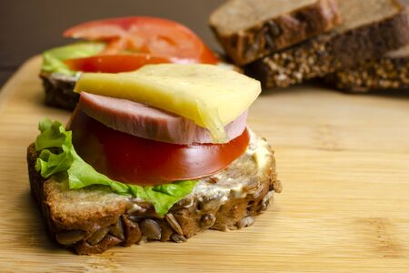 tasty sandwiches with vegetables, cheese and meat close-up, healthy eating concept Standard-Bild