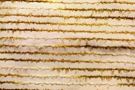 abstract background. beige fringed fabric texture with brown