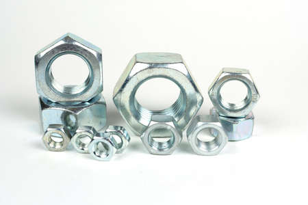 galvanized metal nuts of different sizes close-up