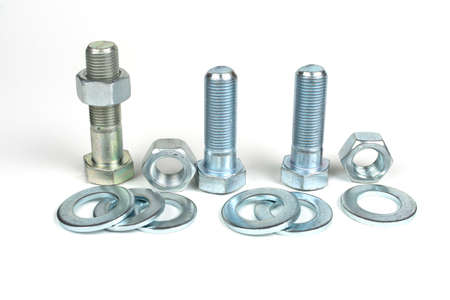 group of bolts and nuts made of metal on a white background