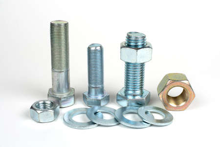 metal bolts with nuts and washers close up