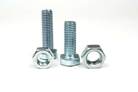 several bolts and nuts made of silver metal close up