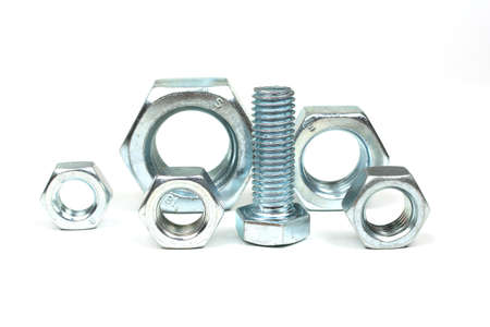 group of large metal nuts and bolts close up