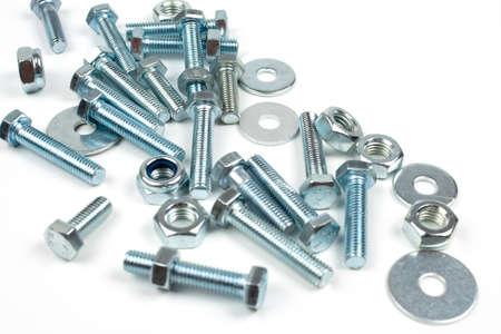 fastening metal bolts and nuts close up Standard-Bild