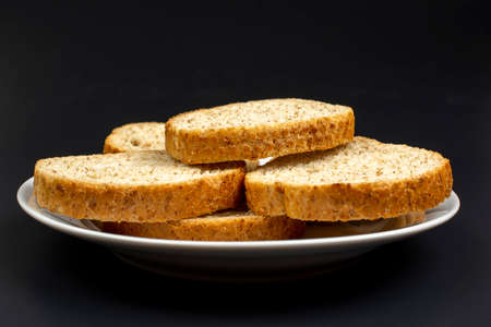 toast bread dried in the oven on a white ceramic plate