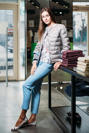shopping, fashion, style, sale, shopping, business and people. concept beautiful happy young woman in a clothing store. the business owner is a clothing store. businesswoman Stock fotó