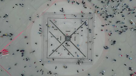 Aerial top down 4k view of people walking in the square.