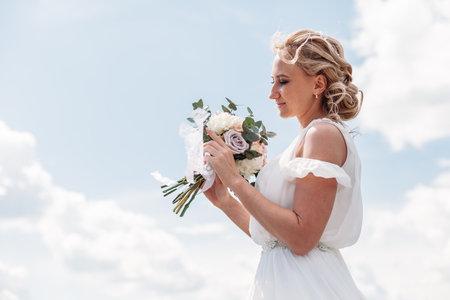 wedding bouquet in hands of the bride. Stock Photo
